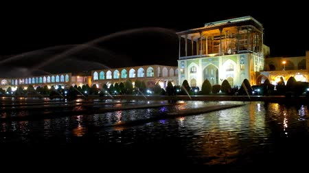 ispahan : The evening walk around the fountains in Nagsh-e Jahan Square, famous for its architectural ensemble, Qapu Palace and long gallery of Grand Bazaar are the notable landmark of it, Isfahan, Iran.