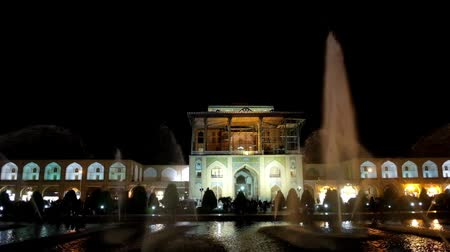ispahan : The evening view of Qapu Palace, located on Nagsh-e Jahan Square with gallery of Grand Bazaar on both sides, Isfahan, Iran.