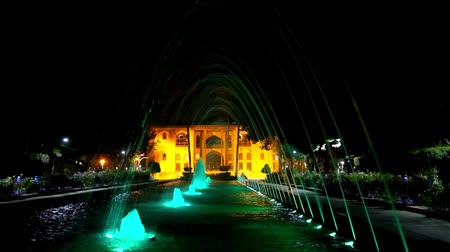 ispahan : ISFAHAN, IRAN - OCTOBER 20, 2017: The Hasht Behest palace boasts beautiful garden with lighting fountains, perfect place for the evening walks, on October 20 in Isfahan.