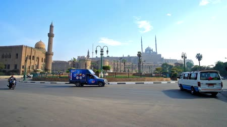 muhammad ali : CAIRO, EGYPT - DECEMBER 21, 2017: Ensemble of Salah El-Deen square, decorated with circle flower bed in the middle and surrounded by medieval mosques and Saladin citadel, on December 21 in Cairo.