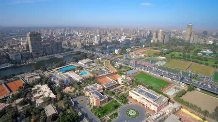 nil : The Cairo Tower overlooks both banks of Nile River - city of Giza and Cairo with Gezira Island in the middle, Egypt.