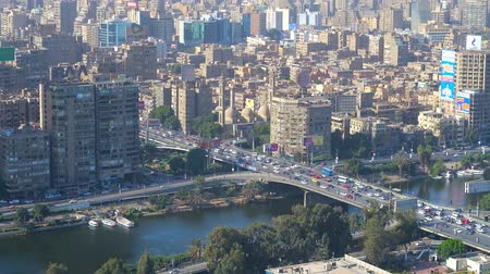 nil : CAIRO, EGYPT - DECEMBER 24, 2017: Aerial view on buildings of Giza, Qasr El Nil bridge and Nile river from the top of Cairo Tower, located on Gezira Island, on December 24 in Cairo
