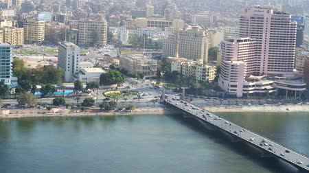 nil : CAIRO, EGYPT - DECEMBER 24, 2017: Aerial view of Tahrir Square in Downtown district and the Qasr El Nil bridge from Cairo Tower on Gezira Island, on December 24 in Cairo Stok Video