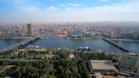 nil : CAIRO, EGYPT - DECEMBER 24, 2017: Aerial view of Downtown district from Gezira Island, separated by Nile river, on December 24 in Cairo