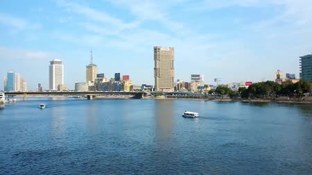 nil : CAIRO, EGYPT - DECEMBER 24, 2017: The pleasure boat is sailing along the Nile river with a view on high rises of Downtown district, on December 24 in Cairo Stok Video