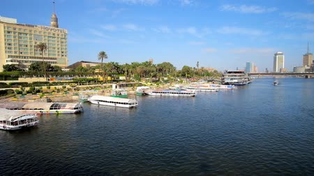 nil : CAIRO, EGYPT - DECEMBER 24, 2017: The tourist harbor of Gezira Island with pleasure boats at the bank of Nile, on December 24 in Cairo