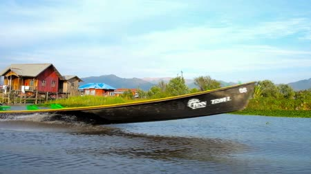 fishing village : INLE LAKE, MYANMAR - FEBRUARY 18, 2018: The trip on Inle Lake is perfect choice to discover local agriculture with floating farms, fishing villages on water and workshops, on February 18 in Inle lake.