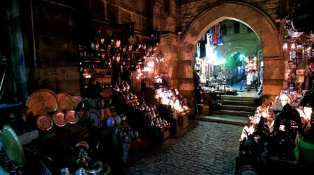 khalili : CAIRO, EGYPT - DECEMBER 21, 2017: The dark corridor of medieval Sel Sela Gate in Khan El Khalili Bazaar is perfect place for Arabian lights stores with multitude of lamps, on December 21 in Cairo