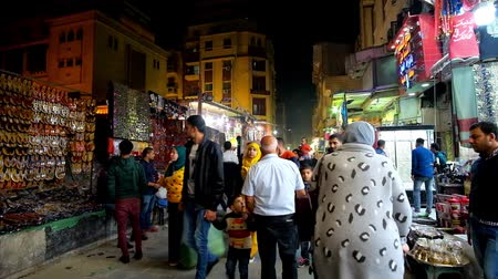 khalili : CAIRO, EGYPT - DECEMBER 22, 2017: Khan EL Khalili market is especially crowded in the evening, locals and tourists enjoy walk and look for some interesting goods, on December 22 in Cairo.