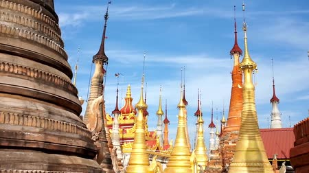karczma : The golden hti umbrellas on the top of medieval stupas of Inn Thein Buddha image Shrine, famous religious and historic site in Indein (Inn Thein) village, Inle Lake, Myanmar.