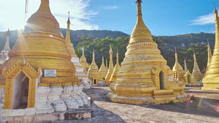 paya : Walk among the carved golden stupas of Nget Pyaw Taw Paya (Pagoda), located at the mountain foot, next to the entrance to Shwe Oo Min Natural Cave, Pindaya, Myanmar. Stock Footage