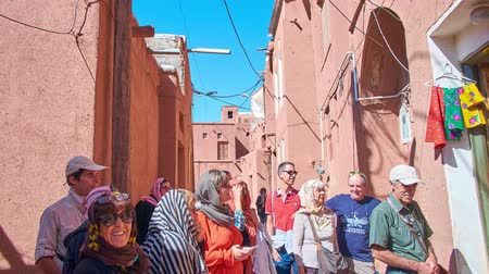 ispahan : ABYANEH, IRAN - OCTOBER 23, 2017: The narrow curved street of the oldest Iranian villages, located on the slope of Karkas Mount and famous for its traditional red clay houses, on October 23 in Abyaneh