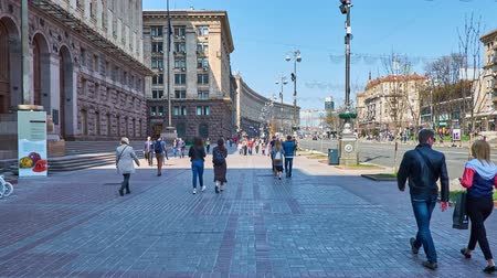 stalinist : KIEV, UKRAINE - APRIL 14, 2018: Walk along Khreshchatyk Avenue - the central city street, with a view on buildings of the Central Department Store and the City Council (Kievrada), on April 14 in Kiev.