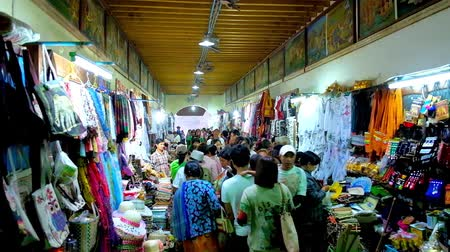 mianmar : BAGAN, MYANMAR - FEBRUARY 24, 2018: The crowded covered tourist market next to Ananda Temple offers variety of local clothes, accessories, souvenirs and religious goods, on February 24 in Bagan.