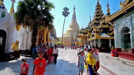 mianmar : YANGON, MYANMAR - FEBRUARY 27, 2018: Visit magnificent Shwedagon Pagoda with huge golden stupa, richly decorated pavilions and masterpiece statues, sculptures and carvings, on February 27 in Yangon