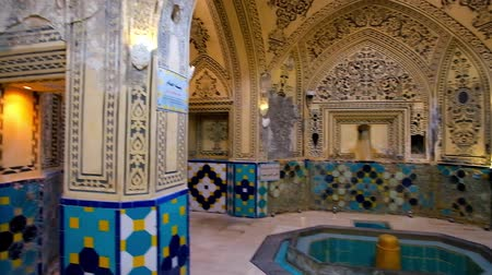 bathhouse : KASHAN, IRAN - OCTOBER 22, 2017: The intricate decoration of medieval hall in Sultan Amir Ahmad Bathhouse, including plasterwork, painted patterns, ornaments of glazed tile, on October 22 in Kashan.