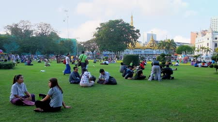 paya : YANGON, MYANMAR - FEBRUARY 15, 2018: People relax on the lawn of  Maha Bandula Garden - the perfect place for picnics and family rest in Downtown, on February 15 in Yangon.