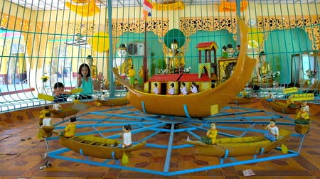 statuette : BAGO, MYANMAR - FEBRUARY 15, 2018: The spinning attraction in pavilion of Shwemawdaw Pagoda - installation depicts religious scene and serves for collecting of donations, on February 15 in Bago.