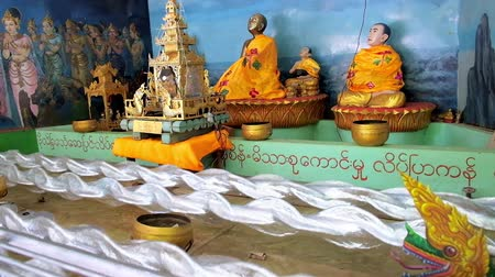 paya : BAGO, MYANMAR - FEBRUARY 15, 2018: The moving installation on religious theme in Shwemawdaw Pagoda pavilion - the dragon appears from stormy waters and hides in waves, on February 15 in Bago.