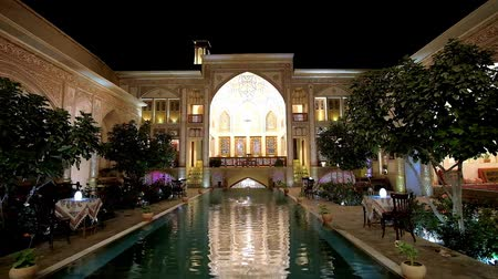 caravanserai : KASHAN, IRAN - OCTOBER 23, 2017: Mahin Saraye Raheb historical house - hotel is best place to spend evening in its cozy restaurant, located in courtyard around the fountain, on October 23 in Kashan.