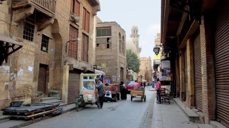 khalili : CAIRO, EGYPT - DECEMBER 20, 2017:The early morning in Al-Muizz street, the stores are still closed and road among historical buildings is almost empty, on December 20 in Cairo.