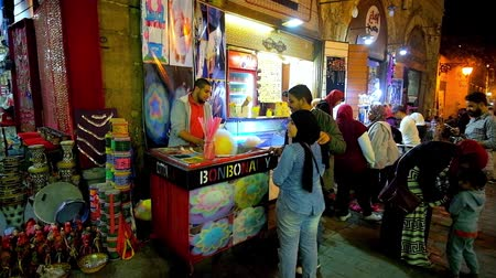 khalili : CAIRO, EGYPT - DECEMBER 22, 2017: Evening Khan El Khalili market in Al-Muizz street is the best place to enjoy sweet cotton candy and watch passers by, on December 22 in Cairo.