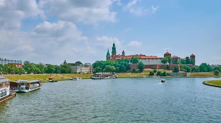 wawel : The green bank of Vistula river with floating restaurants and Wawel Castle on background, Krakow, Poland. Stock Footage