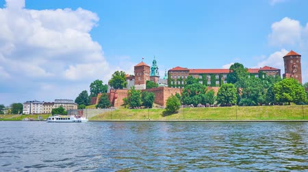 wisla : Panorama of Wawel Castle, its medieval towers and massive rampart are surrounded by lush greenery of riverside garden, Krakow, Poland.