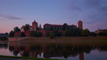 wawel : The purple sunset over the picturesque Wawel Castle, reflected in calm waters of Vistula river, Krakow, Poland.
