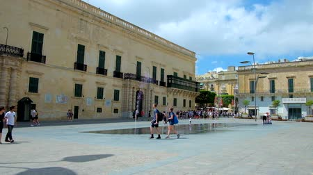 governor : VALLETTA, MALTA - JUNE 17, 2018: Grandmasters Palace, nowadays housing museums and Presidents office, located on Republic street and facing St George Square with fountains, on June 17 in Valletta.