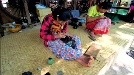 lacquerware : BAGAN, MYANMAR - FEBRUARY 25, 2018: Traditional lacquerware workshop is open for tourists to represent long and hard process of creating authentic Burmese lacquer pieces, on February 25 in Bagan.