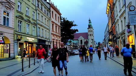 kamienice : KRAKOW, POLAND - JUNE 10, 2018: The evening walk along the shops and cafes of pedestrian Grodzka street with a view on one of the oldest city landmarks - St Andrew Church, on June 10 in Krakow.