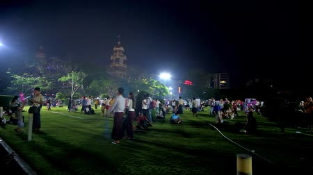 paya : YANGON, MYANMAR - FEBRUARY 14, 2018: The evening picnic in crowded Maha Bandula Garden, located in Downtown and popular among the locals, on February 14 in Yangon. Stock Footage