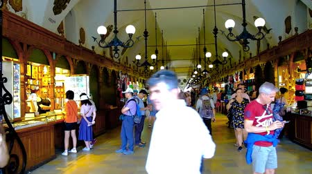 sukiennice : KRAKOW, POLAND - JUNE 10, 2018: Interior of Cloth Hall (Sukiennice) with large amount of handicraft stalls, souvenir shops and art galleries, on June 10 in Krakow.