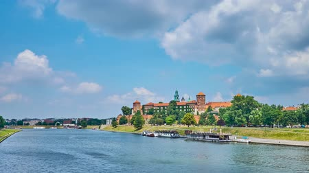 wawel : The picturesque Wawel Castle is hidden among lush greenery of park, covering the bank of Vistula river, Krakow, Poland.