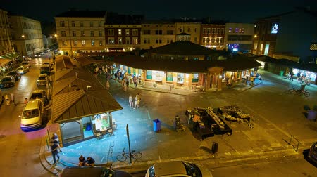 kazimierz : KRAKOW, POLAND - JUNE 21, 2018: The evening on New Square (Plac Nowy) of Kazimierz Jewish Quarter with popular tourist cafes and bars, on June 21 in Krakow.
