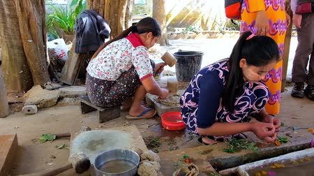 dut : PINDAYA, MYANMAR - FEBRUARY 19, 2018:  The workers of family paper workshop demonstrate the process of traditional Shan paper production, made of mulberry tree fibers, on February 19 in Pindaya.