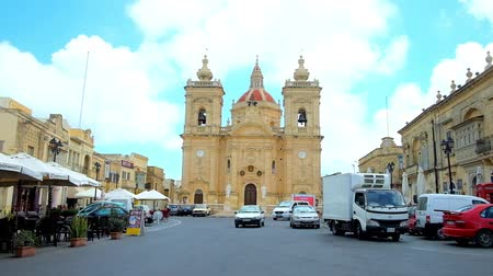 maltština : XAGHRA, MALTA - JUNE 15, 2018: The scenic Basilica of Nativity with huge dome and bell towers with clocks is the pearl of town, located on Knisja street, Gozo Island, on June 15 in Xaghra.