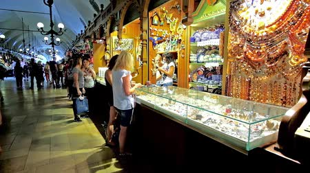 sukiennice : KRAKOW, POLAND - JUNE 11, 2018: The jewelry stall in Cloth Hall (Sukiennice) offers variety of traditional Polish amber and silver pieces, on June 11 in Krakow