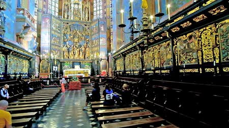 sukiennice : KRAKOW, POLAND - JUNE 11, 2018: The centra nave and apse of Neo-Gothic St Mary Basilica with carved furniture, ornate altar and masterpiece painted decorations, on June 11 in Krakow.