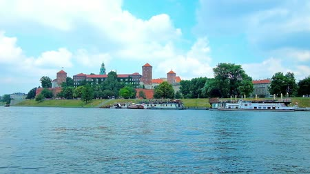 wawel : Embankment of the Vistula river is the perfect viewpoint, overlooking the green garden on the Wawel Hill, topped with medieval Castle - the visit card of Krakow, Poland.