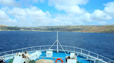 ferry terminal : GHAJNSIELEM, MALTA - JUNE 15, 2018: Enjoy the ferry trip from Malta to Gozo Island with a view on scenic seascape, fast clouds and landscape of Gozo, on June 15 in Ghajnsielem. Stock Footage