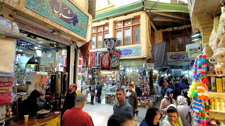 silk road : TEHRAN, IRAN - OCTOBER 25, 2017: Curved alleyway of Tajrish Bazaar with different stalls, carpet shops, the coffee house, offering aroma coffee, boiled in cezve on the sand, on October 25 in Tehran.