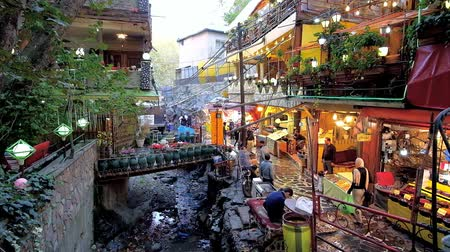 silk road : TEHRAN, IRAN - OCTOBER 25, 2017: The narrow alley of Darband mountain resort with scenic cafes and restaurants along the river and hiking trail, leading to Mount Tochal, on October 25 in Tehran.
