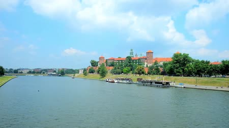 wawel : The Wawel Castle is towering among lush greenery on the bank of Vistula river, Krakow, Poland.