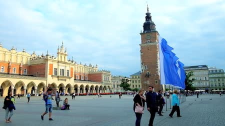 sukiennice : KRAKOW, POLAND - JUNE 12, 2018: The scenic Main Market Square with historic building of Cloth Hall (Sukiennice), serving as the handicraft market, and preserved Town Hall Tower, on June 12 in Krakow.
