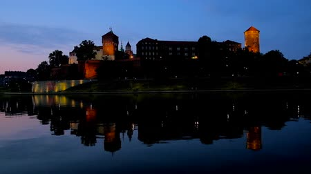wawel : The twilights over the medieval subdued lighted Wawel Castle, reflecting on pure surface of Vistula river, Krakow, Poland.