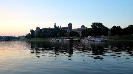 wawel : The last sunset beams are reflected in waters of Vistula river, running along the medieval Wawel Castle, one of the most important landmarks of Krakow, Poland.