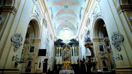 クラクフ : KRAKOW, POLAND - JUNE 21, 2018: The prayer hall of St Stanislaus Church at Skalka with rich carved decors on walls and at the altar, on June 21 in Krakow