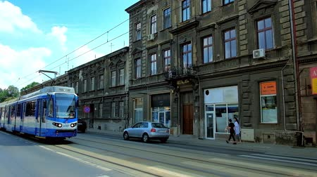 panské sídlo : KRAKOW, POLAND - JUNE 21, 2018: The blue tram rides along Boleslawa Limanowskiego street in Podgorze district with old edifices on background, on June 21 in Krakow.